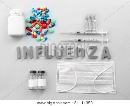 Medicines with word Influenza on light background