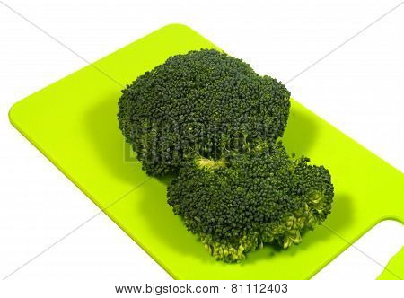 Isolated cutting board with broccoli