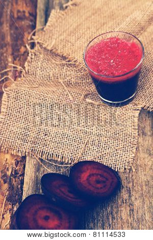 Beetroot drink on a wooden table