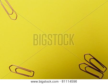 Paper clip on a yellow background
