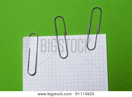 Office. Paper clip with a paper on the table