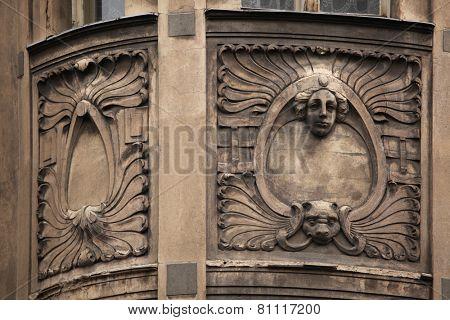 Floral ornamental decoration and mascaron on the the Art Nouveau building in Prague, Czech Republic.