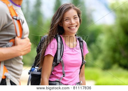 Hiker. Woman hiking smiling happy on trek with backpack during summer outdoors activity. Fresh joyful multiethnic Asian Caucasian female model walking in Yosemite National Park, California, USA