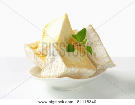 Wedges of French white rind cheese