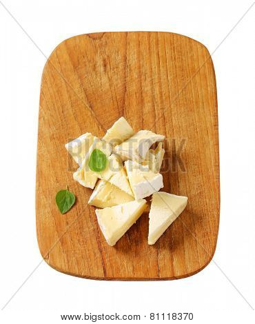 Pieces of French white rind cheese