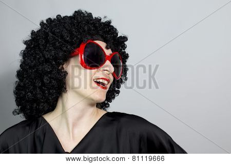 Funny Red Lipstic Women Wearing A Black Wig With Red Eyeglasses And Posing, Isolated Copy Space Back