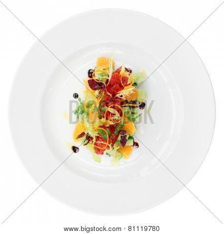Tuna tartar with cucumber and orange isolated on white background