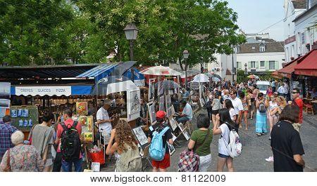 Visitors At An Art Market In Monmatre, Paris France.