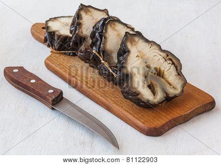 Cut Pieces Of Smoked Sturgeon On A Cutting Board