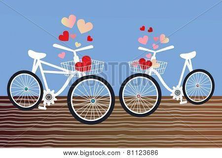 Male and female Bicycles on the boardwalk hearts in the baskets