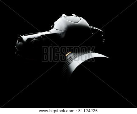 Professional Modern Full-Frame DSLR Camera with Lens on the Black Background