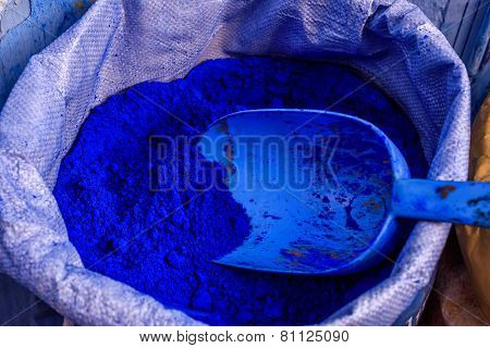 Sack of blue wall paint in Chefchaouen, Morocco