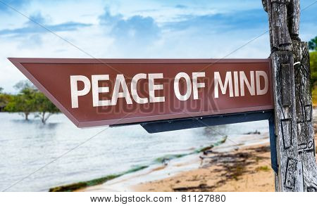 Peace of Mind wooden sign with a lake background