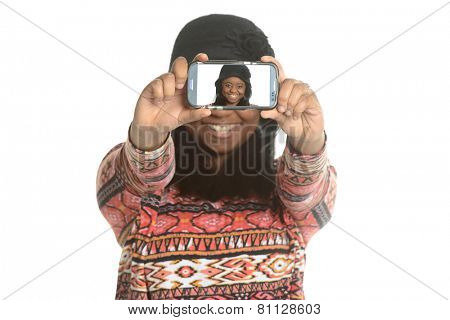Black young woman taking a selfie isolated on a white background