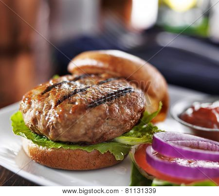 turkey burger on bun with lettuce and fixings