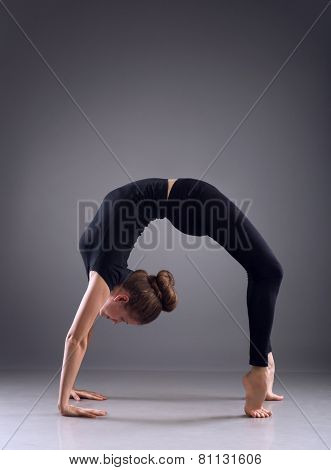 Young woman in handstand position