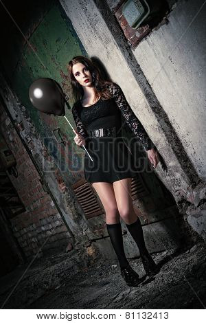 Strange Young Girl Holding Black Balloon