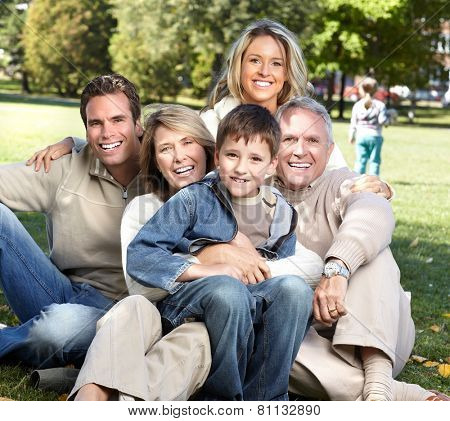 Happy family over park nature background. Recreation
