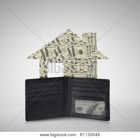 dollars in bills spilling out of a billfold