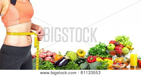 Woman measuring her body. Diet and healthy nutrition.