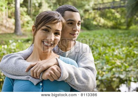 Portrait Of Hispanic Mother And Teen Son Outdoors
