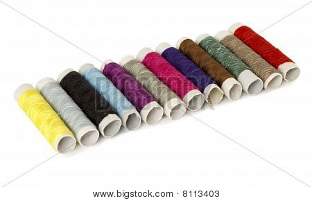 Colored Spools Of Thread Isolated On White
