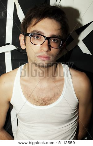 Young Brunette Guy In Stylish Glasses