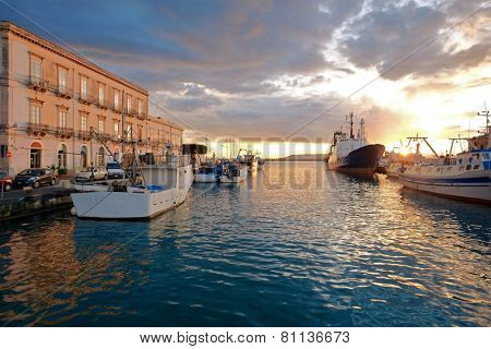 colorful sunset on the harbor of Ortigia Islet Of Siracusa, Sicily