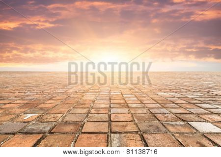By bricks tiles in sunset