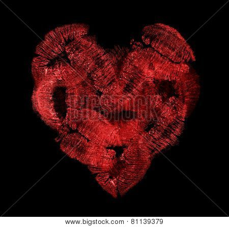heart from red lips imprints isolated on black background
