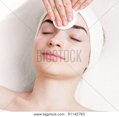 Young woman make up removing in beauty parlour