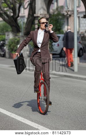 woman through the city with the unicycle to go to work, outdoor