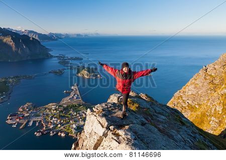 sporty women on the top of mountain over ocean