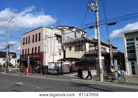 Street In Sub-urban In Kyoto With Telephone Poles And Traffic