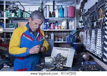 Mechanic At His Workshop.