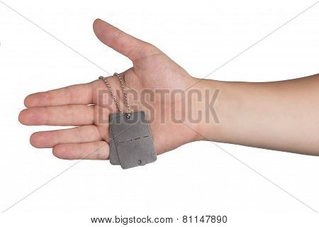 Hand Holding Dog Tags