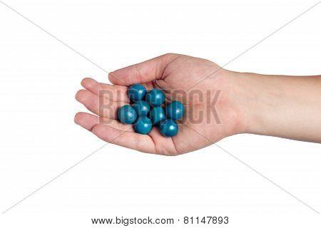 Hand Holding Paint Balls