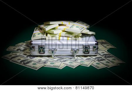 Metallic case with dollars on green table