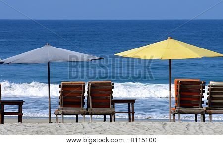 Colorful Beach Umbrellas With Seats
