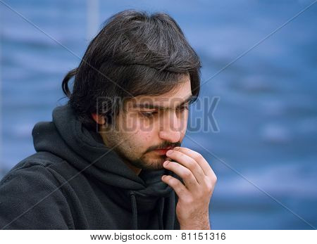 Portrait of a Caucasian man who has pondering.