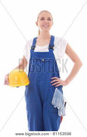 Dreaming Woman In Blue Builder Uniform Holding Yellow Helmet Isolated On White