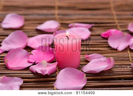 Rose with rose petals, salt in wooden bowl on mats