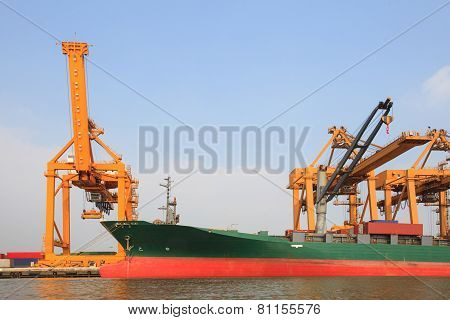 Commercial Ship On Port  With Big Loading Crane