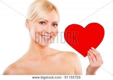 Love and valentines day woman holding heart smiling cute isolated on white background.