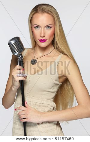 Female with silver microphone