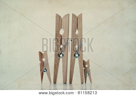 Family. Abstract: The Family Of Linen Clothespins. Man, Woman With Children. Vintage Paper Backgroun
