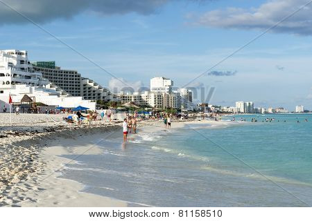 CANCUN - JANUARY 18: Tourists enjoy the sunny weather and relaxing on the beautiful beach on 18 January 2015 in Cancun, Mexico. This is one of the best beaches in the Mexico.