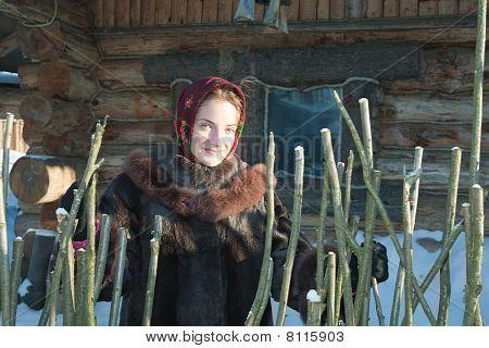 Girl Wooden House In Winter