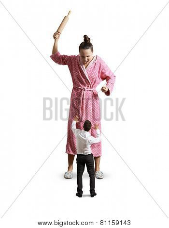 angry housewife with rolling pin screaming at small startled husband. isolated on white background