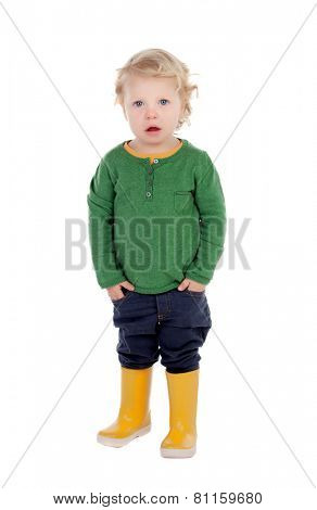 Adorable blond baby with yellow gumboots isolated on a white background